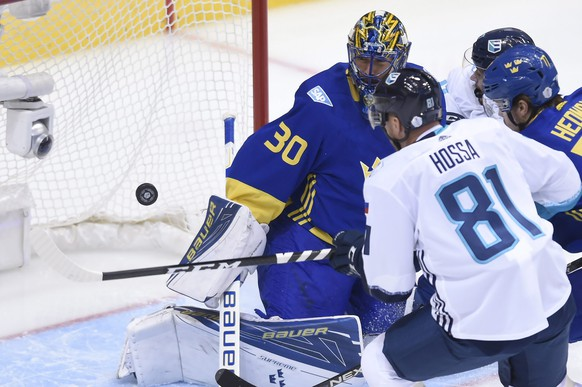 Team Sweden goaltender Henrik Lundqvist (30) makes a save against Team Europe's Marian Hossa during first-period World Cup of Hockey semifinal action in Toronto, Sunday, Sept. 25, 2016. (Nathan Denette/The Canadian Press via AP)