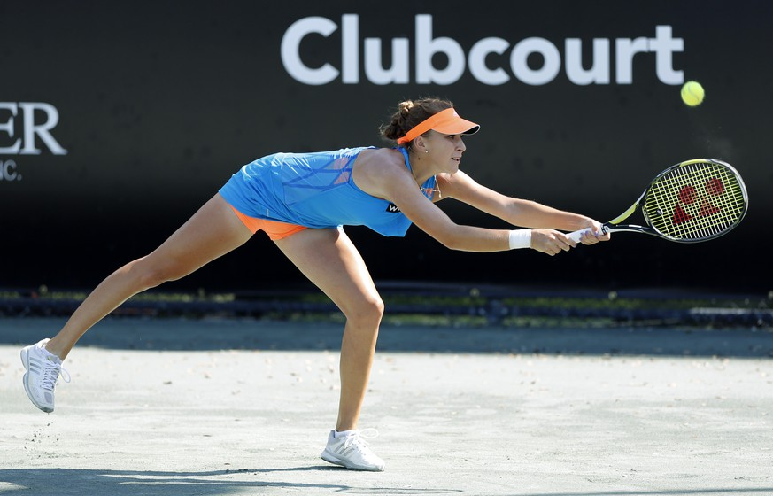 Belinda Bencic, of Switzerland, returns to Elina Svitolina, of Ukraine, during the Family Circle Cup tennis tournament in Charleston, S.C., Thursday, April 3, 2014. (AP Photo/Mic Smith)