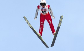epa04629151 Switzerland's Simon Ammann soars through the air during the training session of the Ski Jumping HS-100 individual competition at the Nordic Skiing World Championships in Falun, Sweden, 20 February 2015.  EPA/GRZEGORZ MOMOT POLAND OUT