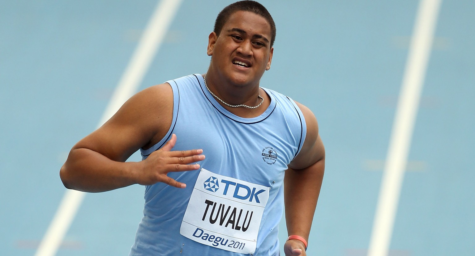 DAEGU, SOUTH KOREA - AUGUST 27:  Sogelau Tuvalu of American Samoa competes in the men's 100 metres preliminary round during day one of the 13th IAAF World Athletics Championships at the Daegu Stadium on August 27, 2011 in Daegu, South Korea.  (Photo by Ian Walton/Getty Images)