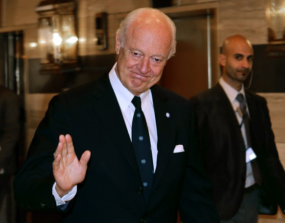 United Nations Italian envoy on the Syrian crisis, Staffan de Mistura, leaves his hotel for a meeting on September 10, 2014 in Damascus. De Mistura, on his first Damascus visit as the new UN envoy on the Syrian conflict, is to hold talks with President Bashar al-Assad tomorrow, a newspaper close to the regime said.  AFP PHOTO / LOUAI BESHARA