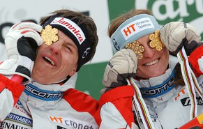 Croatian Ivica Kostelic and his sister Janica show the medals they won at the Alpine Ski World Championships in St. Moritz, Switzerland, Sunday, February 16, 2003.  (KEYSTONE/Eddy Risch)