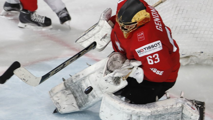 Switzerland's Leonardo Genoni makes a save during the Ice Hockey World Championships group B match between Switzerland and Finland in the AccorHotels Arena in Paris, France, Sunday, May 14, 2017. (AP Photo/Petr David Josek)