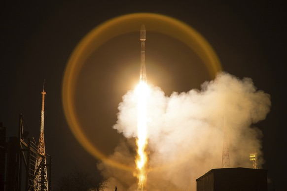 In this handout photo released by Roscosmos Space Agency Press Service, A Soyuz-2.1b launch vehicle takes-off with another 34 OneWeb satellites from the Baikonur Cosmodrome in Kazakhstan, Kazakhstan, Saturday, March 21, 2020. (Roscosmos Space Agency Press Service via AP)