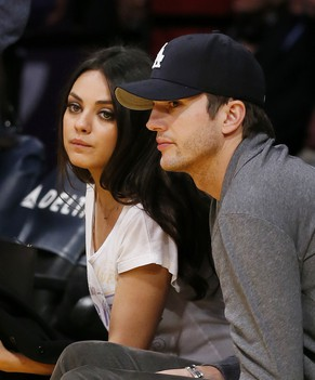 Actress Mila Kunis, left, and actor Ashton Kutcher, right, sit courtside together at the NBA basketball game between the Phoenix Suns and Los Angeles Lakers on Tuesday, February 12, 2013, in Los Angeles. (AP Photo/Danny Moloshok).