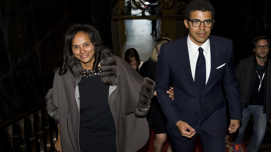 In this March 5, 2015 photo, Isabel dos Santos, reputedly Africa's richest woman, and her husband and art collector Sindika Dokolo arrive for a ceremony at the City Hall in Porto, Portugal. On Monday, Jan. 6, 2020, Angolan Foreign Minister Manuel Augusto said that there is no political motivation behind the government's demand for more than $1 billion from dos Santos, her husband and a Portuguese business partner. Isabel dos Santos is a daughter of Jose Eduardo dos Santos, who ruled the oil- and diamond-rich nation for 38 years until 2017. (AP Photo/Paulo Duarte)
