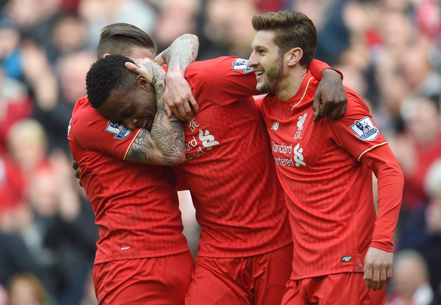 epa05253060 Liverpool's Divock Origi (C) is congratulated by Alberto Moreno (L) and Adam Lallana (R) after scoring the fifth goal making the score 4-1 during the English Premier League soccer match between Liverpool and Stoke City at the Anfield, Manchester, Britain, 10 April 2016.  EPA/PETER POWELL EDITORIAL USE ONLY. No use with unauthorized audio, video, data, fixture lists, club/league logos or 'live' services. Online in-match use limited to 75 images, no video emulation. No use in betting, games or single club/league/player publications