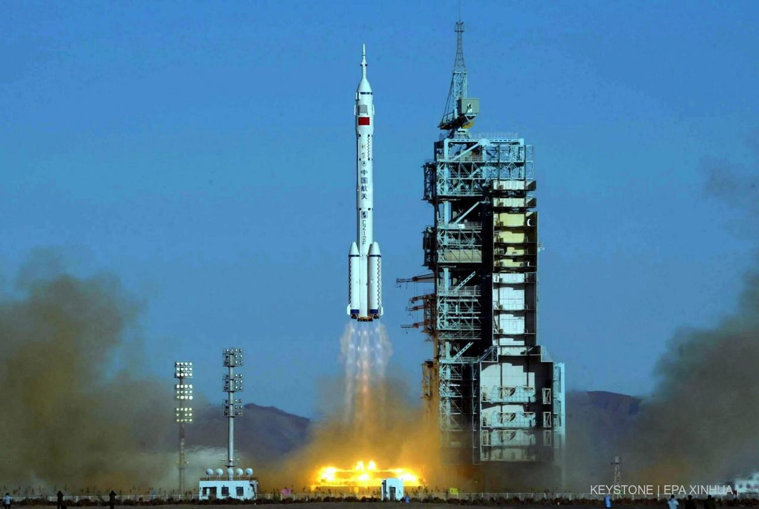 The Long March 2F rocket with Shenzhou V capsule carrying 38 year old Yang Liwei, the first Chinese to go into space, takes off from a desert launch pad in the Inner Mongolian autonomous region in western China 250km from the Jiuquan space centre Wednesday15 October 2003. EPA/-