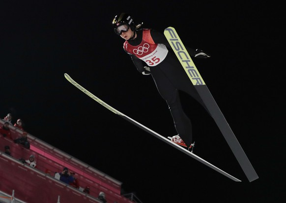 Maren Lundby, of Norway, soars through the air during the women's normal hill normal hill individual ski jumping competition at the 2018 Winter Olympics in Pyeongchang, South Korea, Monday, Feb. 12, 2018. (AP Photo/Kirsty Wigglesworth)