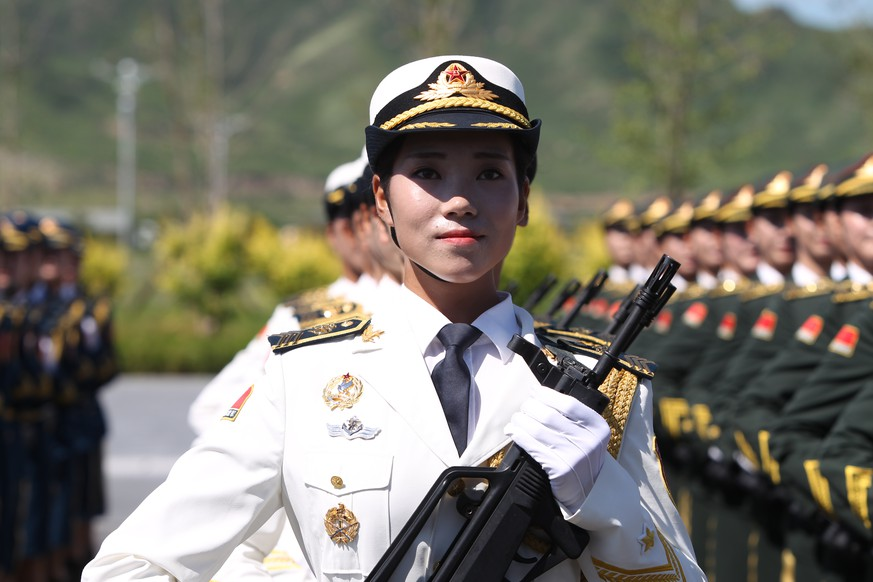 BEIJING, CHINA - AUGUST 22:  (CHINA OUT) A female soldier from the Chinese People's Liberation Army attends a training session for the September 3 military parade to mark the 70th anniversary of the victory of the Chinese People's War of Resistance Against Japanese Aggression at a military base on August 22, 2015 in Beijing, China.  (Photo by ChinaFotoPress/ChinaFotoPress via Getty Images)
