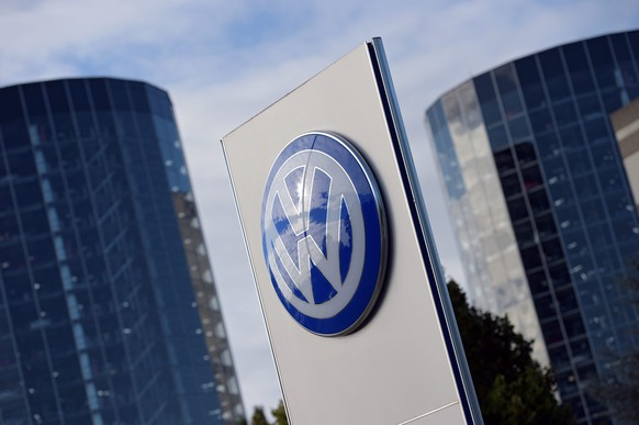 epa04999558 (FILE) A file photo dated 25 September 2015 of the corporate logo of German car maker Volkswagen (VW) in front of the storage towers of Volkswagen's so-called 'Autostadt' (car city) in Wolfsburg, Germany. Media reports on 28 October 2015 said that Volkswagen reports a 3.5-billion-euro (3.9-billion-dollar) loss for the third quarter as it absorbs the impact of its emissions cheating scandal.  EPA/RAINER JENSEN