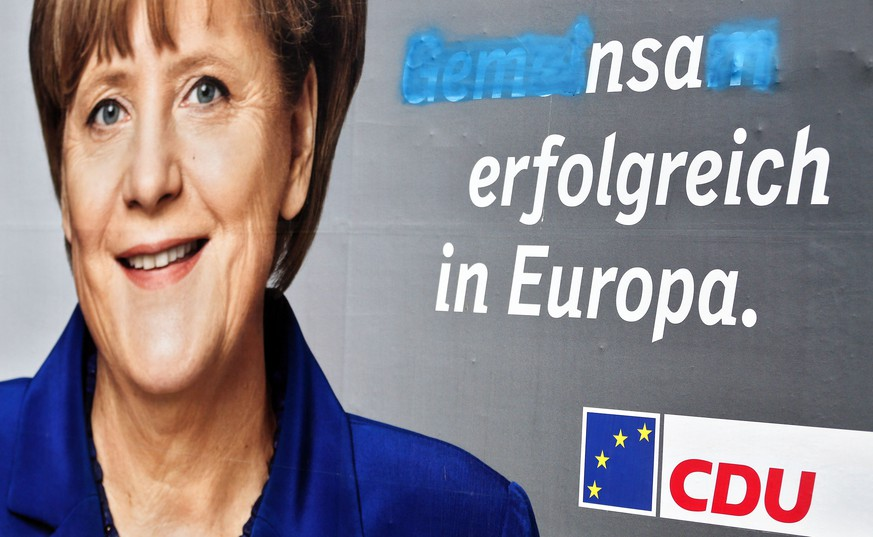 An election campaign poster showing German Chancellor Angela Merkel of the conservative Christian Democratic Union (CDU) is pictured on May 19, 2014 in Halle an der Saale, eastern Germany, some days before the European elections. The slogan reading
