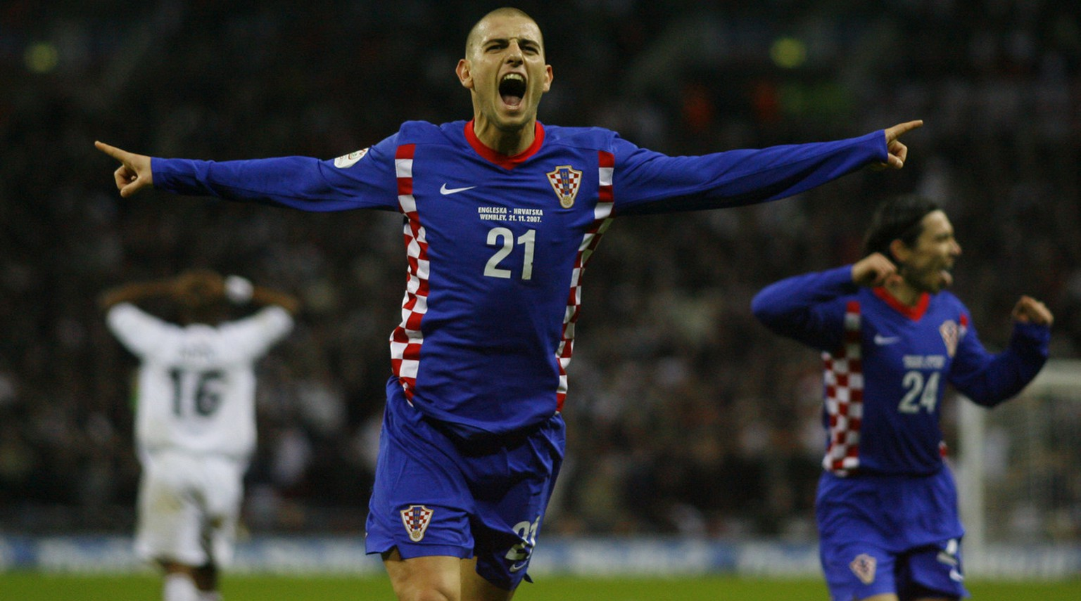 Croatia's Mladen Petric celebrates after scoring his side's winning goal during the Euro 2008 group E qualifying soccer match between England and Croatia at Wembley Stadium in London, Wednesday Nov. 21, 2007.  England failed to qualify for the tournament on Wednesday after losing at Wembley 3-2 to Croatia.  (AP Photo/Tom Hevezi)