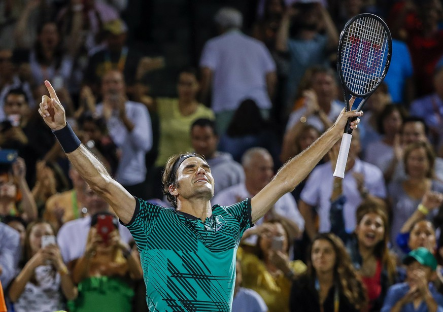 epaselect epa05881959 Roger Federer of Switzerland reacts after defeating Nick Kyrgios of Australia during a semifinal round match at the Miami Open tennis tournament on Key Biscayne, Miami, Florida, USA, 31 March 2017. Federer will face Rafael Nadal of Spain in the men's singles finals on 02 April.  EPA/ERIK S. LESSER