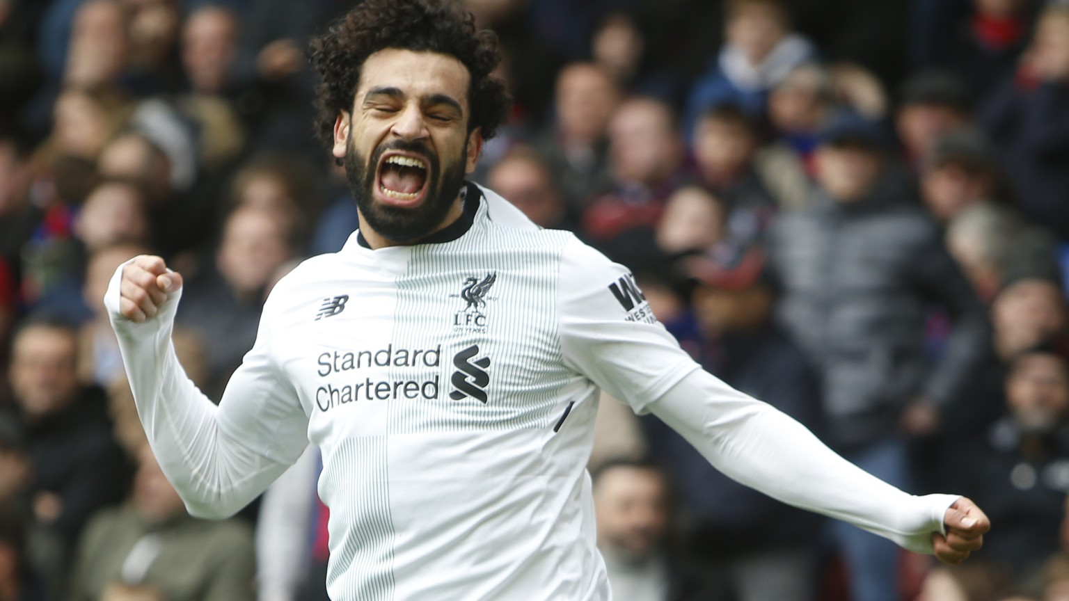 Liverpool's Mohamed Salah celebrates after scoring his side's second goal of the game, during the English Premier League soccer match between Crystal Palace and Liverpool at Selhurst Park stadium in London, Saturday, March, 31, 2018. Liverpool won the game 2-1. (AP Photo/Alastair Grant)