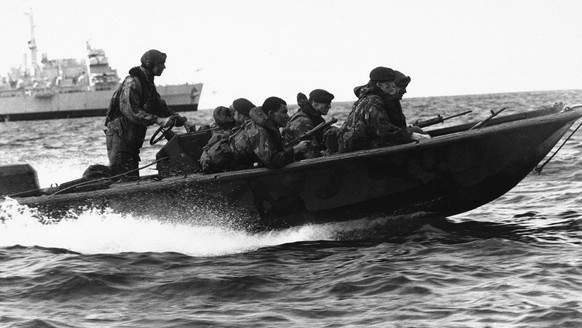This photo was made available by the British Ministry of Defense in London on May 21, 1982.   Royal Marine Commandos use an assault boat, to practice landings, during training at Ascension Island in the Atlantic Ocean in May 1982.   According to the British Ministry of Defence in London, British troops, including Marines and paratroops, mounted a number of landings on the Argentinian-held Falkland Islands.  (AP Photo/pool)