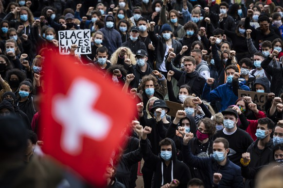 People demonstrate against racism during a protest in Lausanne, Switzerland, Saturday, 13 June 2020. Worldwide protests continue to take place prompted by the death last month of George Floyd by police officers in Minneapolis, USA that has led to protests in many countries and across the US calling for an end to racial injustice. (Jean-Christophe Bott/Keystone via AP)