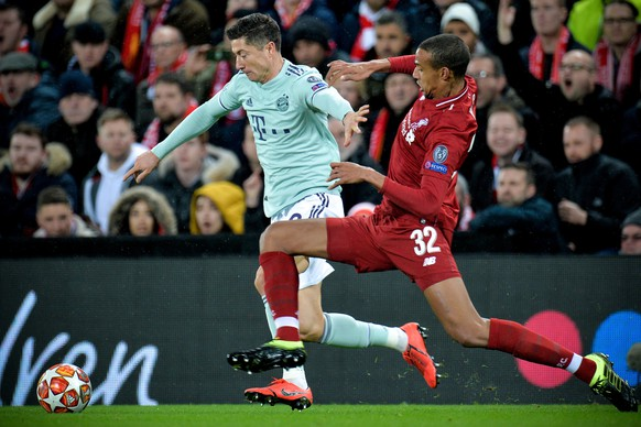 epa07381641 Liverpool's Joel Matip (R) in action against Bayern's Robert Lewandowski (L) during the UEFA Champions League round of 16 first leg soccer match between Liverpool FC and FC Bayern Muenchen at the Anfield in Liverpool, Britain, 19 February 2019.  EPA/PETER POWELL