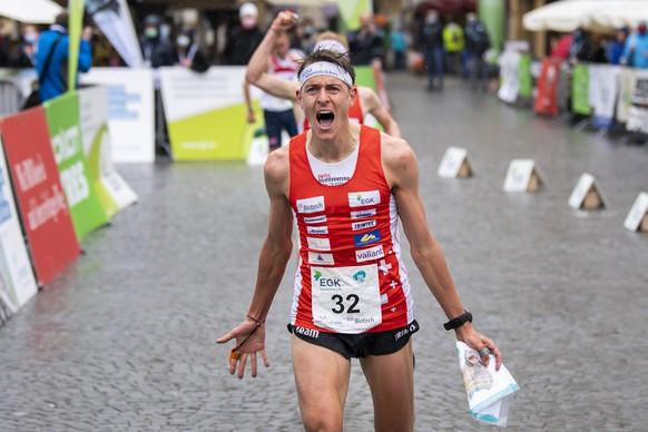 The winner Matthias Kyburz of Switzerland celebrates as he crosses the finish line during the men's KO-Sprint final race at the European Orienteering Championships in Neuchatel, Switzerland, Saturday, May 15, 2021. (KEYSTONE/Jean-Christophe Bott)