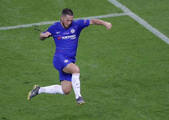 Chelsea's Eden Hazard celebrates after scoring his team's fourth goal during the Europa League Final soccer match between Chelsea and Arsenal at the Olympic stadium in Baku, Azerbaijan, Wednesday, May 29, 2019. (AP Photo/Dmitri Lovetsky)