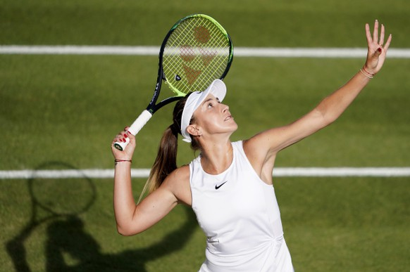 epa07695293 Belinda Bencic of Switzerland in action against Kaia Kanepi of Estland during their second round match at the Wimbledon Championships at the All England Lawn Tennis Club, in London, Britain, 04 July 2019. EPA/NIC BOTHMA EDITORIAL USE ONLY/NO COMMERCIAL SALES