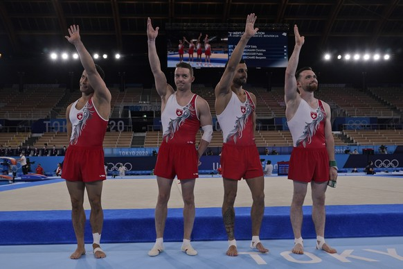 from left Switzerlan's Eddy Yusof, Christian Baumann, Benjamin Gischard and Pablo Braegger wave after performing their routines for the men's artistic gymnastic qualifications at the 2020 Summer Olympics, Saturday, July 24, 2021, in Tokyo. (AP Photo/Gregory Bull)