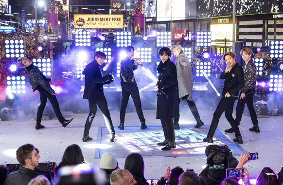 FILE - Members of BTS perform at the Times Square New Year's Eve celebration in New York on Dec. 31, 2019. The South Korean boy band BTS HAS won a leading four awards including best song for