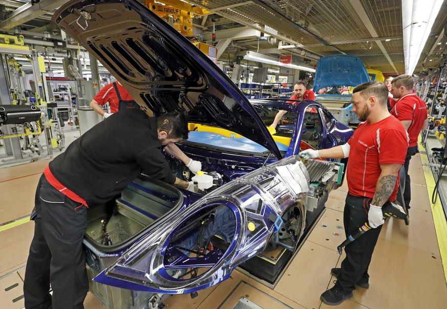 epa07478088 (FILE) - A view of the production of different sports cars at an assembly line at the German car manufacturer Porsche in Stuttgart, Germany, 19 February 2019 (reissued 01 April 2019). Reports on 01 April 2019 state the IHS Markit institute reporting German purchasing manager index has fallen 3,5 points to 44,1 points, an 80-month low and its lowest figure since 2012. The incoming orders and orders for export have both suffered from a decline not seen since the global financial crisis, the institute said. For the Eurozone, IHS Markit's final Eurozone manufacturing PMI stood at 47,5 points in March, down from February's final figure 49,3 points, marking its biggest monthly decline in new orders since the end of 2012.  EPA/RONALD WITTEK