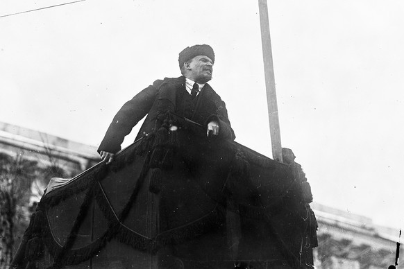 In this photo taken in Nov. 7 1918, provided by Russian State Archive of Social and Political History, Soviet leader Vladimir Lenin addresses a crowd during the first year of Revolution in Red Square in Moscow, Russia. The Kremlin is avoiding any official commemoration of the centennial of the 1917 revolution, tip-toeing around the event that remains polarizing for many, as the historic wounds of the revolution have not healed for the descendants of the event(Russian State Archive of Social and Political History via AP)