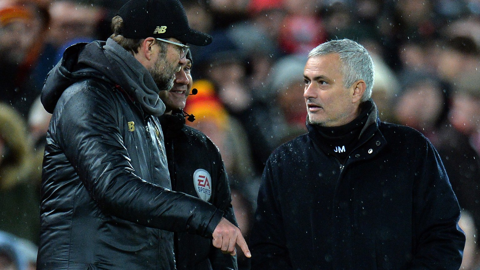 epa07235927 Manchester United manager Jose Mourinho (R) and Liverpool head coach Jurgen Klopp (L) during the English Premier League soccer match between Liverpool FC and Manchester United FC at Anfield in Liverpool, Britain, 16 December 2018.  EPA/PETER POWELL EDITORIAL USE ONLY. No use with unauthorized audio, video, data, fixture lists, club/league logos or 'live' services. Online in-match use limited to 120 images, no video emulation. No use in betting, games or single club/league/player publications.