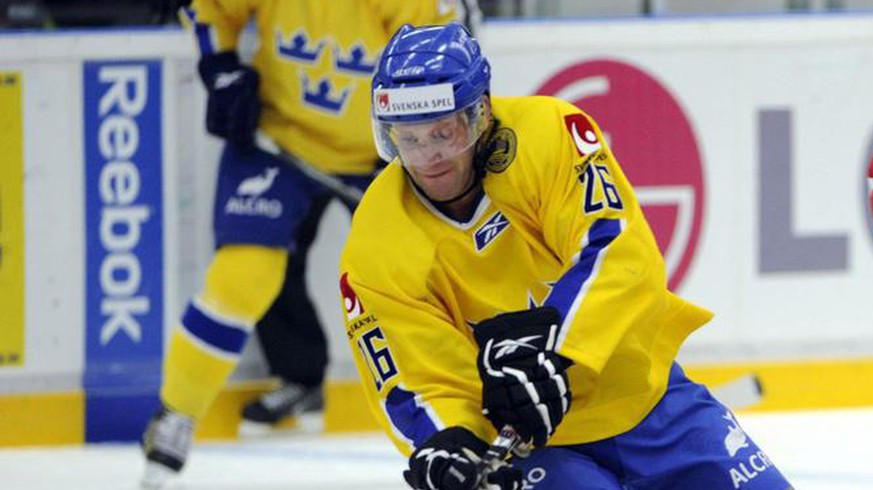 Sweden's Marcus Nilsson, left, fights for the puck with Kim Staal of Denmark, right, during a friendly match in Lindab Arena in Angelholm, Sweden, Wednesday May 5, 2010. (AP Photo/Pontus Lundahl/Scanpix Sweden) ** SWEDEN OUT **
