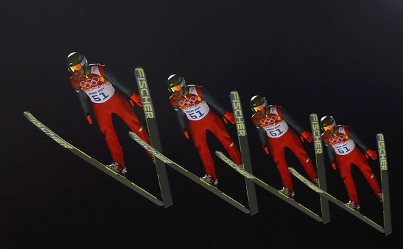 Poland's Kamil Stoch soars through the air in his trial jump during a qualifying session for the men's ski jumping large hill individual event during the Sochi 2014 Winter Olympic Games, at the RusSki Gorki Ski Jumping Center in Rosa Khutor, February 14, 2014. Picture taken using multiple exposure.    REUTERS/Michael Dalder (RUSSIA  - Tags: OLYMPICS SPORT SKIING)