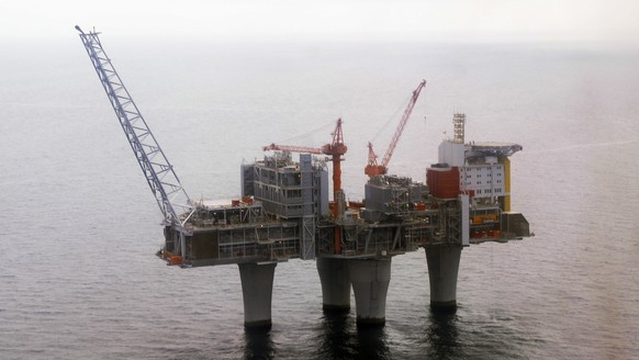 FILE - In this June 8 2006 file photo, The Troll, a gas platform run by the Norwegian oil giant Statoil company, stands above the North Sea, about 70 kilometers off the coast of Norway. Norway's $1 trillion wealth fund will begin dumping its shares in oil and gas companies, paving the way for a huge divestment in the likes of Royal Dutch Shell and Exxon Mobil, Minister of Finance Siv Jensen said Friday March 8, 2019. (Marit Hommedal / Scanpix via AP, File)