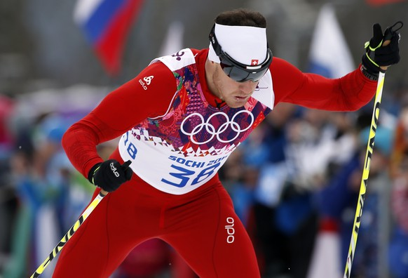 Switzerland's Dario Cologna competes during qualifications of the men's cross-country sprint at the 2014 Winter Olympics, Tuesday, Feb. 11, 2014, in Krasnaya Polyana, Russia. (AP Photo/Felipe Dana)