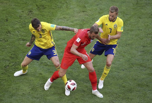 England's Harry Kane fights for the ball with Sweden's Victor Lindelof and Sebastian Larsson, right, during the quarterfinal match between Sweden and England at the 2018 soccer World Cup in the Samara Arena, in Samara, Russia, Saturday, July 7, 2018. (AP Photo/Thanassis Stavrakis)