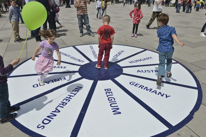 epa05296642 Children play on a circle with the names of various European countries during the events to celebrate Europe Day 2016 in Pristina, Kosovo, 09 May 2016. Europe Day, which is supported by the  European Union Rule of Law Mission in Kosovo (EULEX Kosovo) is celebrated on 09 May with a variety of cultural and sport events to promote the EU's values such as 'human rights, democracy, freedom of expression', as Xavier de Marnhac, the EULEX Head of Mission, was quoted as saying on an EU External Action website.  EPA/PETRIT PRENAJ
