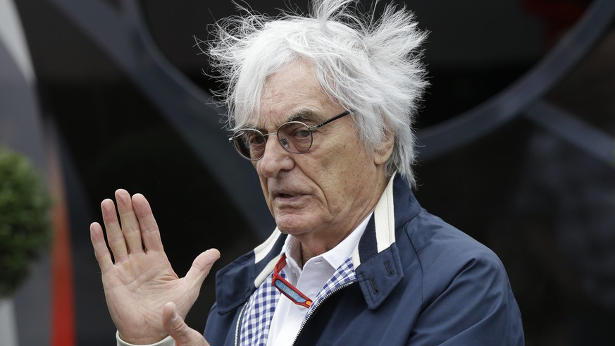 Formula Ones' chief executive Bernie Ecclestone gestures at a paddock after the third free practice at the Silverstone racetrack, Silverstone, England, Saturday, July 9, 2016. The British Formula One Grand Prix will be held on Sunday July 10. (AP Photo/Luca Bruno)