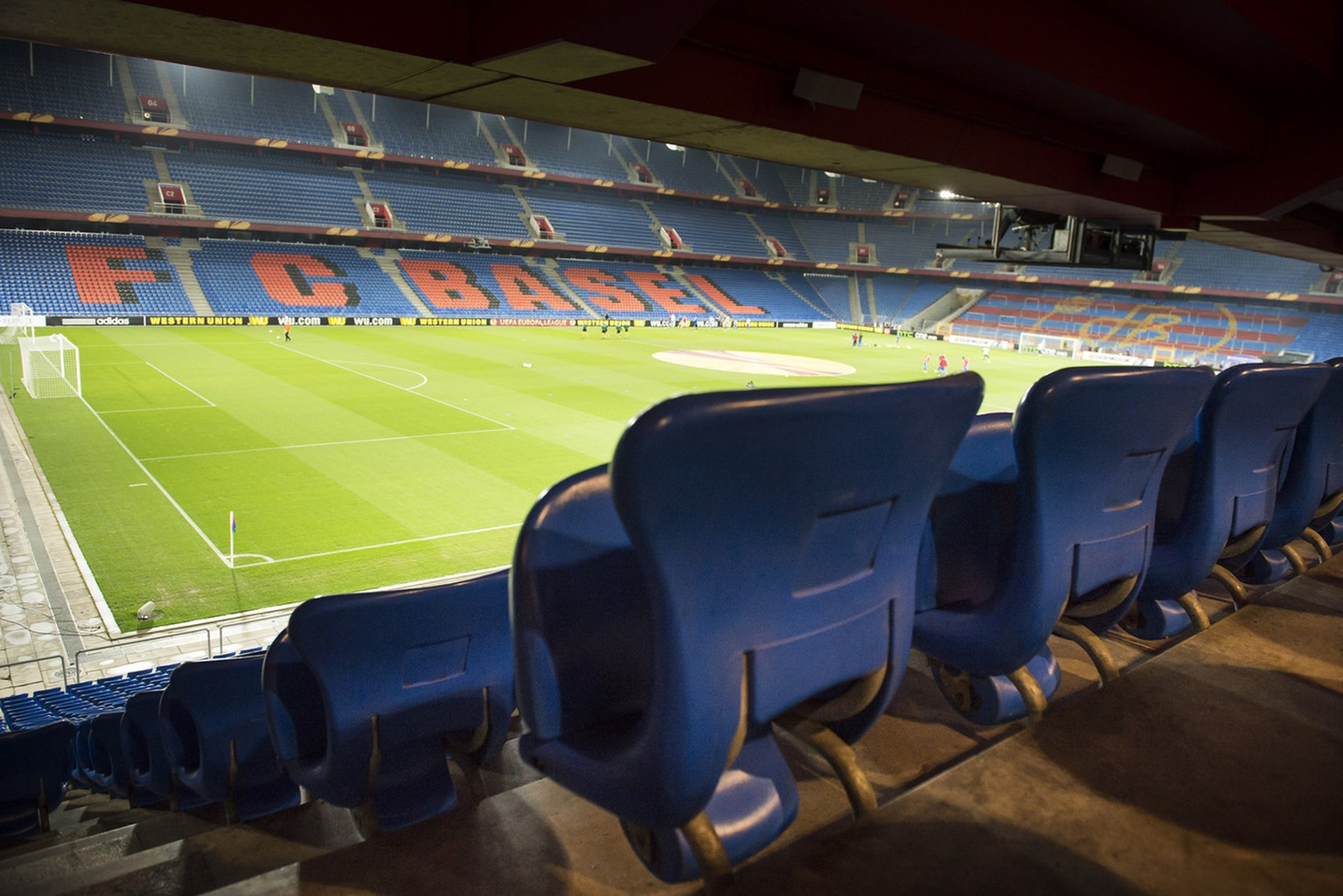 A general view of the stadium with empty chairs are pictured before the UEFA Europa League quarter final first leg soccer match between Switzerland's FC Basel 1893 and Spain's Valencia CF behind closed doors at the St. Jakob-Park stadium in Basel, Switzerland, on Thursday, April 3, 2014. (KEYSTONE/Jean-Christophe Bott)