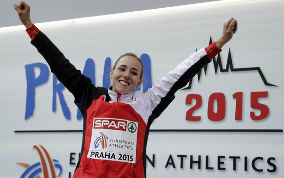 Switzerland's Selina Buechel celebrates her gold medal in 800m women's race at the European Athletics Indoor Championships in Prague, Czech Republic, Sunday, March 8, 2015. (AP Photo/Petr David Josek)