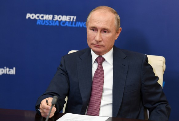 "Russian President Vladimir Putin attends an annual VTB Capital ""Russia Calling!"" Investment Forum via video conference at the Novo-Ogaryovo residence outside Moscow, Russia, Thursday, Oct. 29, 2020. (Alexei Nikolsky, Sputnik, Kremlin Pool Photo via AP)"