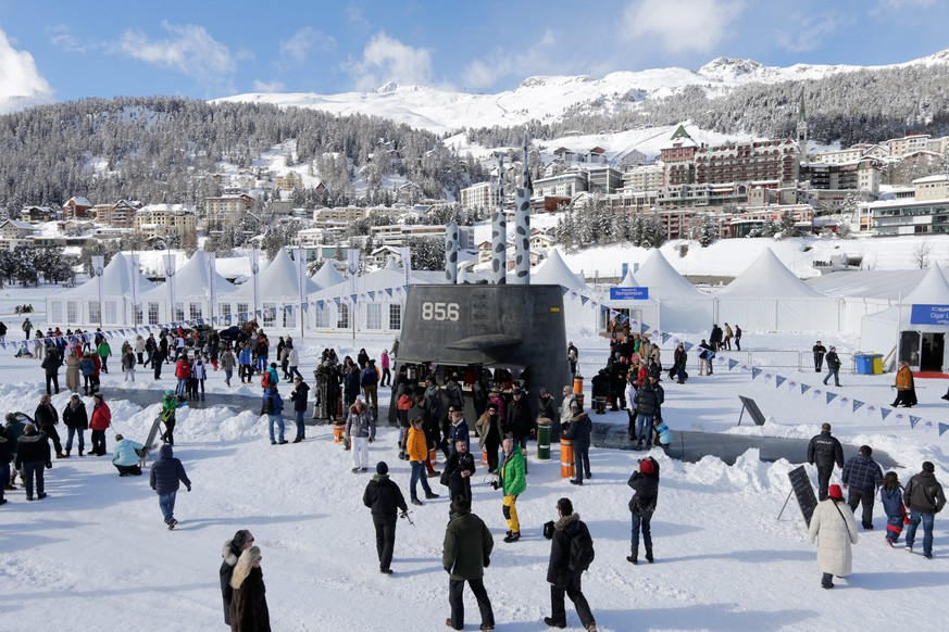 epa04064250 A submarine boat built by Swiss artist Andreas Reinhard in the frozen lake of St. Moritz, during the White Turf horse races on Snow in St. Moritz, Switzerland, 09 February 2014. Inside the submarine is a Champagne and Sushi Bar.  EPA/ARNO BALZARINI