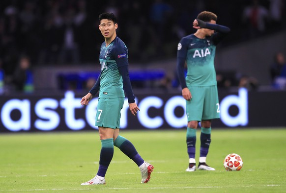Tottenham's Son Heung-Min and Dele Alli, background, react after Ajax's Hakim Ziyech scored his side's second goal during the Champions League semifinal second leg soccer match between Ajax and Tottenham Hotspur at the Johan Cruyff ArenA in Amsterdam, Netherlands, Wednesday, May 8, 2019. (AP Photo/Peter Dejong)