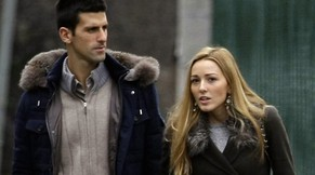 "FILE - In this Feb. 6, 2013 file photo Serbia's tennis player Novak Djokovic, left, and his girlfriend Jelena Ristic arrive for a visit to a school for mentally challenged children in Belgrade, Serbia.  Djokovic said during a TV show Monday Feb. 3, 2014, that he will soon marry his fiance and long-time girlfriend Jelena Ristic. On Monday, the world No. 2-ranked tennis player and six-time major champion told Ristic during a Serbian television talk show: ""Jelena, enjoy it while you can. In a couple of months you will be changing your last name to Djokovic."" and Jelena was shown smiling. (AP Photo/Darko Vojinovic, FILE)"