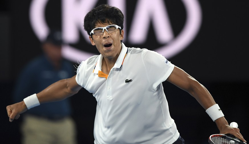 South Korea's Chung Hyeon reacts after winning a point against Serbia's Novak Djokovic during their fourth round match at the Australian Open tennis championships in Melbourne, Australia, Monday, Jan. 22, 2018. (AP Photo/Andy Brownbill)