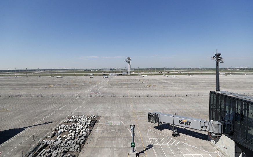 epa05974453 General view of the empty docking area with the control tower at the background in the Berlin Brandenburg Airport (BER) still under construction, in Schoenefeld, Germany, 19 May 2017. Members of a main committee of the Berlin Parliament visited the airport and received on site information about the latest developments in the building and how ongoing errors are being fixed. Construction works in the airport started in 2006 but the expected inauguration in 2010 never took place. Errors in planning, bad management and over expenses are still delaying its official opening.  EPA/FELIPE TRUEBA
