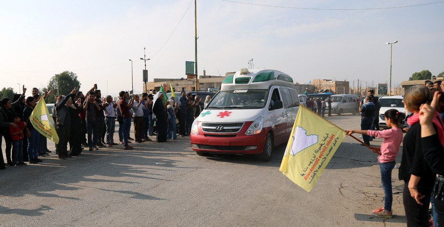 epa07937048 Syrian Kurds wave off ambulances carrying fighters of Syria democratic forces (SDF) and civilian who were wounded during the Turkish offensive, upon their arrival to receive the medical treatments at the local hospitals in Tal Tamr town, northeastern of Syria, 20 October 2019. Turkey has launched an offensive targeting Kurdish forces in north-eastern Syria on 09 October, days after the US withdrew troops from the area On 17 October Turkish President Erdogan and US Vice President Mike Pence have reached a ceasefire agreement.  EPA/AHMED MARDNLI