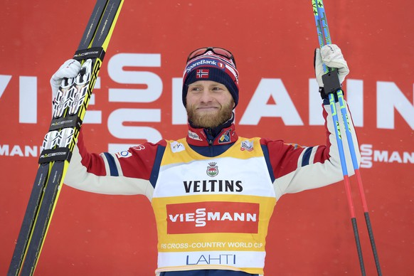 Norway's Martin Johnsrud Sundby celebrates on the podium after winning the Men's Skiathlon 15km classic and 15km free style event of the FIS Cross Country Skiing World Cup, the Lahti Ski Games in Lahti, Finland, February 21, 2016. REUTERS/Martti Kainulainen/LehtikuvaATTENTION EDITORS - THIS IMAGE WAS PROVIDED BY A THIRD PARTY. FOR EDITORIAL USE ONLY. NOT FOR SALE FOR MARKETING OR ADVERTISING CAMPAIGNS. THIS PICTURE IS DISTRIBUTED EXACTLY AS RECEIVED BY REUTERS, AS A SERVICE TO CLIENTS. NO THIRD PARTY SALES. NOT FOR USE BY REUTERS THIRD PARTY DISTRIBUTORS. FINLAND OUT. NO COMMERCIAL OR EDITORIAL SALES IN FINLAND.