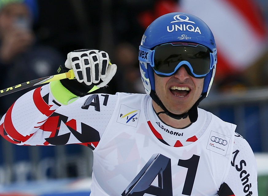 Matthias Mayer of Austria reacts in the finish area during the men's downhill of the Alpine Skiing World Cup in Saalbach Hinterglemm February 21, 2015.                 REUTERS/Leonhard Foeger (AUSTRIA  - Tags: SPORT SKIING)