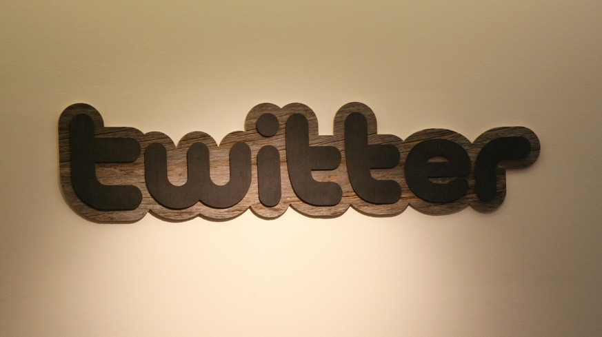(FILES) IN this March 11, 2011 file photo, the Twitter logo is displayed at the entrance of Twitter headquarters in San Francisco, California.  Twitter on September 8, 2014 began testing
