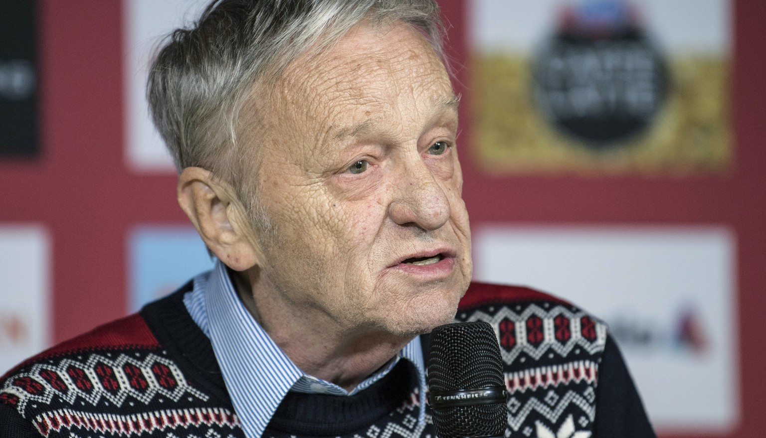 FILE - In this Feb. 19, 2017, file photo, Gian Franco Kasper, president of the International Ski Federation, speaks during a press conference in St. Moritz, Switzerland. A group of winter sports athletes and the world's biggest snowboard maker want the president of the International Ski Federation to resign after he spoke of